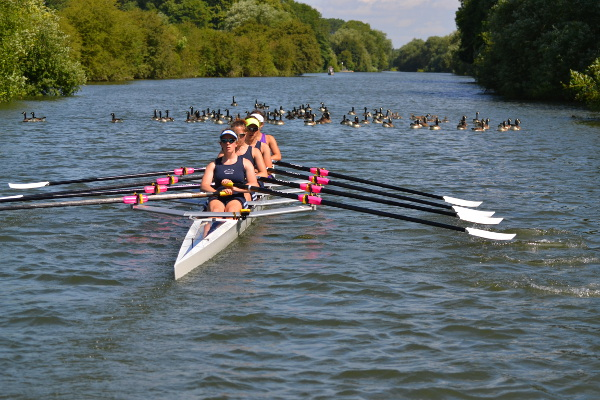 Oxford University Women's Lightweight Rowing Club in a boat on the Thames